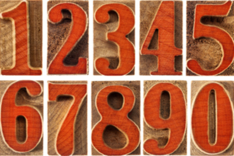 a set of isolated ten numbers from zero to nine in letterpress wood type printing blocks stained by red ink