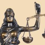 XI – La Justicia
